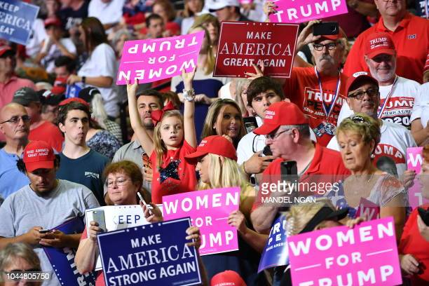 Supporters of US President Donald Trump attend a Make America Great Again rally at Landers Center in Southaven Mississippi on October 2 2018