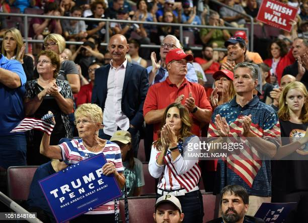 Supporters of US President Donald Trump attend a 'Make America Great Again' rally at Erie Insurance Arena on October 10 in Erie Pennsylvania