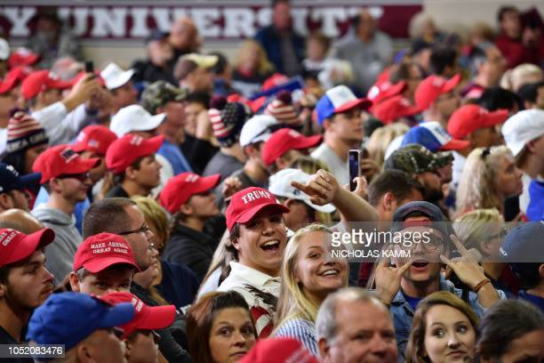 Supporters of US President Donald Trump attend a Make America Great Again rally at the Eastern Kentucky University in Richmond Kentucky on October 13...