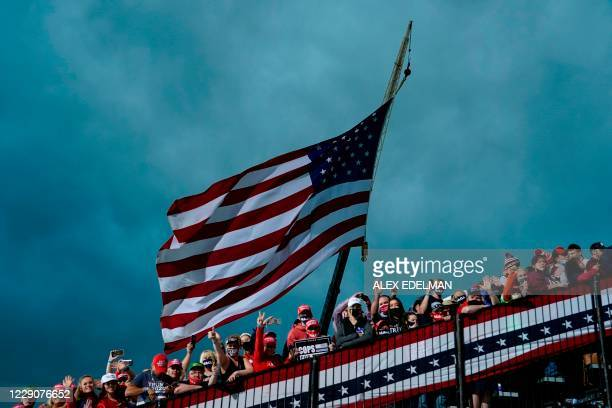 Supporters of US President Donald Trump attend a Make America Great Again campaign event at Des Moines International Airport in Des Moines, Iowa on...