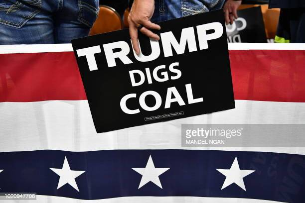 Supporters of US President Donald Trump attend a political rally at Charleston Civic Center in Charleston, West Virginia, on August 21, 2018. -...