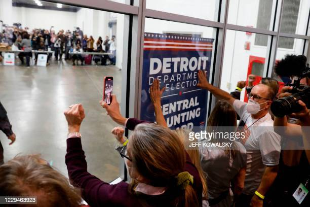 Supporters of US President Donald Trump bang on the glass and chant slogans outside the room where absentee ballots for the 2020 general election are...