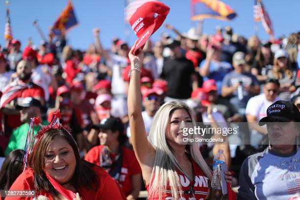 """Supporters of U.S. President Donald Trump chant """"Latinos for Trump!"""" during a campaign rally at Phoenix Goodyear Airport October 28, 2020 in..."""