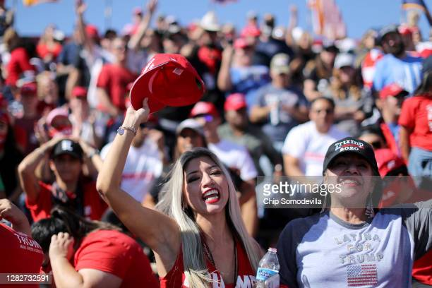 "Supporters of U.S. President Donald Trump chant ""Latinos for Trump!"" during a campaign rally at Phoenix Goodyear Airport October 28, 2020 in..."