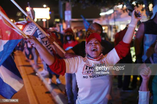 Supporters of U.S. President Donald Trump cheer outside of the Versailles restaurant as they await the results of the presidential election on...