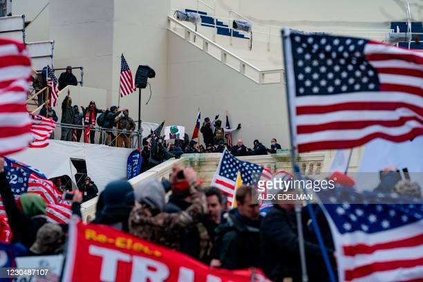 Supporters of US President Donald Trump clash with the US Capitol police during a riot at the US Capitol on January 6 in Washington, DC. - Donald...