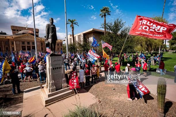 Supporters of US President Donald Trump demonstrate in front of the Arizona State Capitol in Phoenix, Arizona, on November 7, 2020. - Democrat Joe...