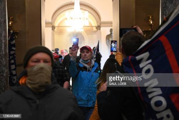 Supporters of US President Donald Trump enter the US Capitol on January 6 in Washington, DC. - Demonstrators breeched security and entered the...