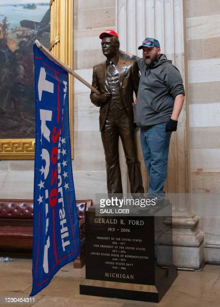Supporters of US President Donald Trump enter the US Capitol's Rotunda on January 6 in Washington, DC. - Demonstrators breeched security and entered...