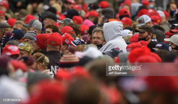 Supporters of U.S. President Donald Trump gather before a campaign rally at North Coast Air aeronautical services at Erie International Airport on...