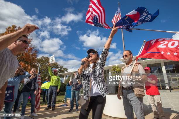 Supporters of US President Donald Trump gather in front of the State Capitol in Raleigh, North Carolina, to protest against election results and...