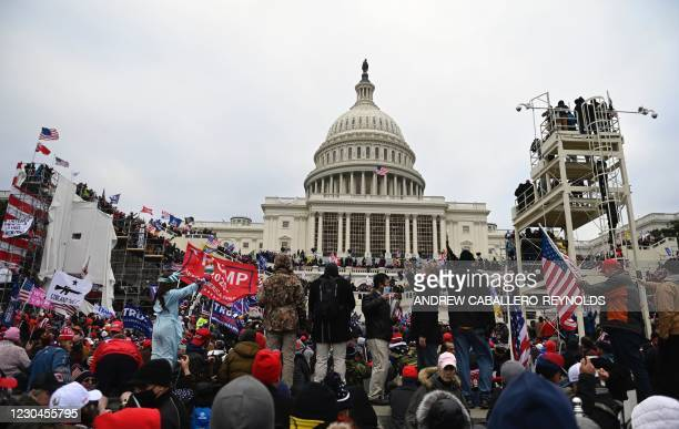 Supporters of US President Donald Trump gather outside the US Capitol on January 6 in Washington, DC. - Demonstrators breeched security and entered...