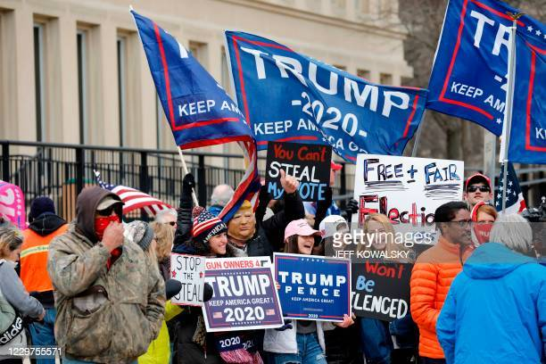 Supporters of US President Donald Trump gather to make their opinion heard outside the Michigan State Capital as Michigan's Board of State Canvassers...