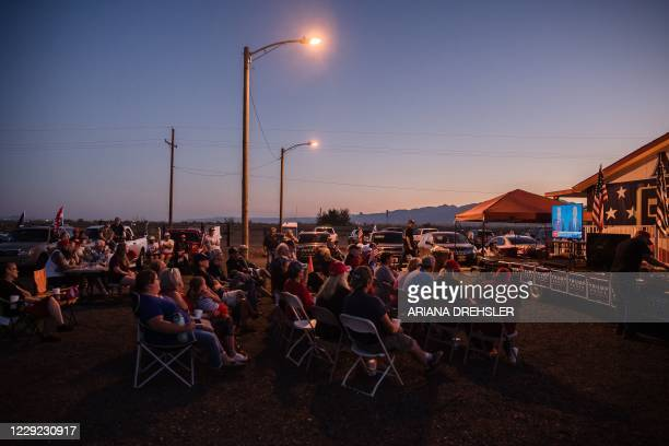 Supporters of US President Donald Trump gather to watch the last presidential debate outside the Great American Pizza and Subs restaurant in Golden...