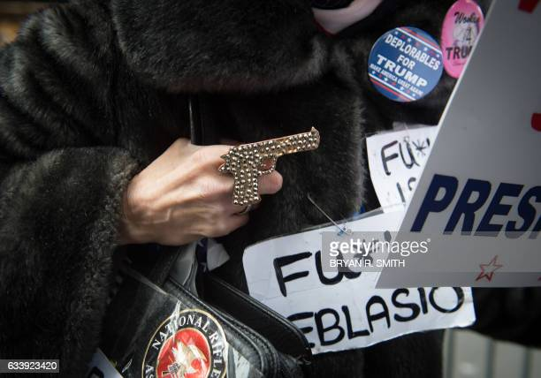 Supporters of US President Donald Trump hold a rally near Trump Tower in Fifth Avenue February 5 2017 in New York / AFP / Bryan R Smith