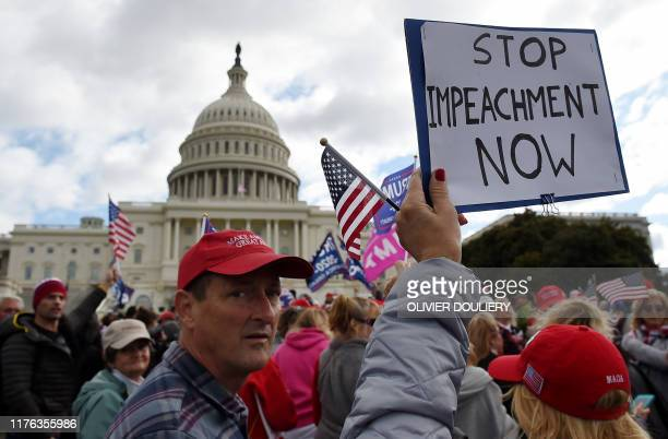 Supporters of US President Donald Trump hold a Stop Impeachment rally in front of the US Capitol October 17 2019 in Washington DC