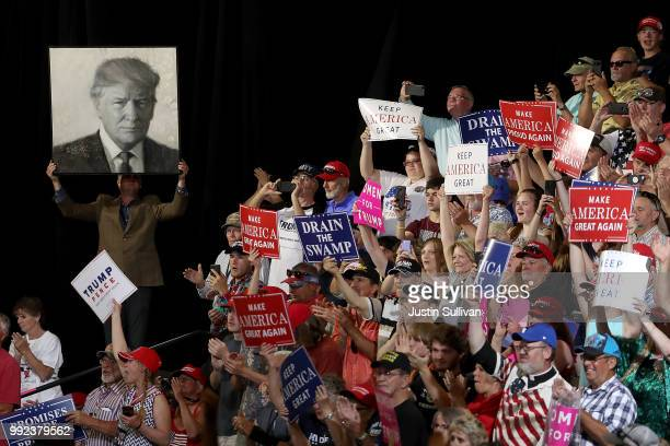 Supporters of US president Donald Trump hold signs during a campaign rally at Four Seasons Arena on July 5 2018 in Great Falls Montana President...
