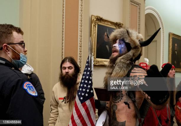 Supporters of US President Donald Trump, including Jake Angeli , a QAnon supporter known for his painted face and horned hat, protest in the US...