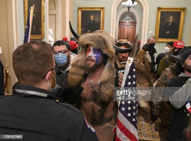 Supporters of US President Donald Trump, including member of the QAnon conspiracy group Jake A, aka Yellowstone Wolf , enter the US Capitol on...
