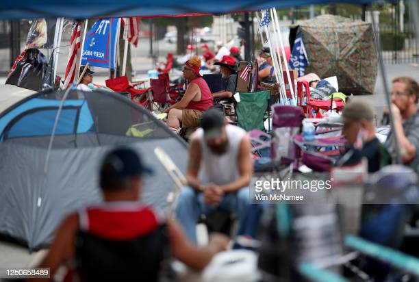 Supporters of U.S. President Donald Trump line up to attend the Trump's campaign rally near the BOK Center, site of tomorrow's rally, June 19, 2020...
