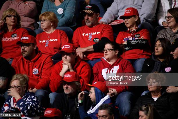Supporters of US President Donald Trump listen to him speak at a Make America Great Again rally on April 27 2019 in Green Bay Wisconsin