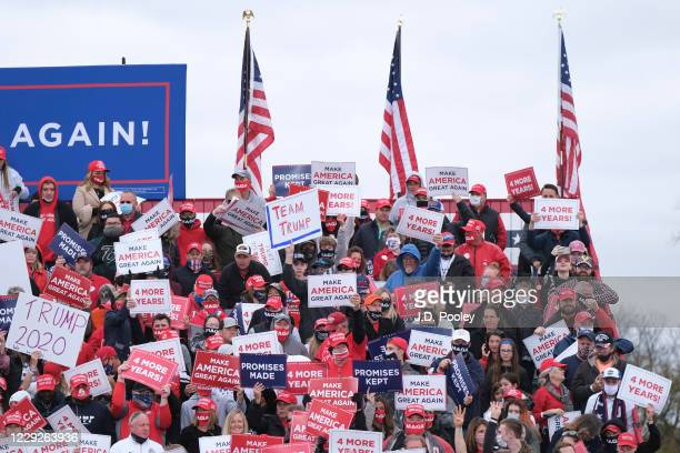 Supporters of U.S. President Donald Trump look on ahead of a campaign event on October 24, 2020 in Circleville, Ohio. President Trump continues to...