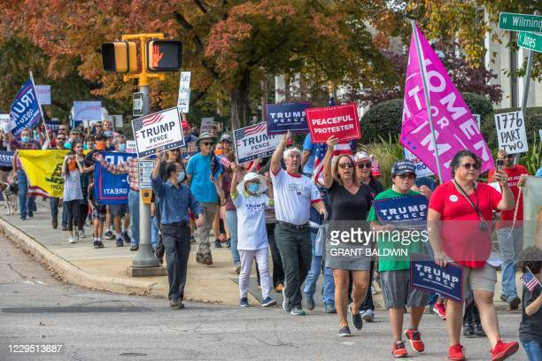 Supporters of US President Donald Trump march to the State Capitol in Raleigh North Carolina to protest against election results and perceived...
