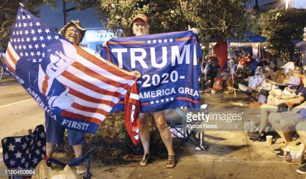 Supporters of US President Donald Trump pose in Orlando Florida on June 17 as they line up outside the venue of a campaign rally to be held the...