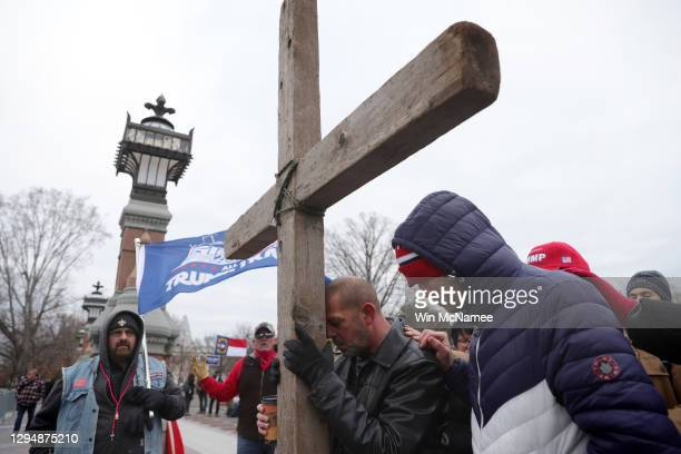 Supporters of U.S. President Donald Trump pray outside the U.S. Capitol January 06, 2021 in Washington, DC. Congress will hold a joint session today...