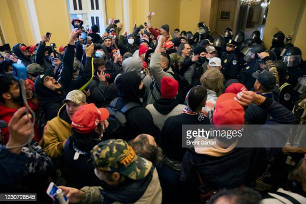 Supporters of US President Donald Trump protest inside the US Capitol on January 6 in Washington, DC. Demonstrators breeched security and entered the...