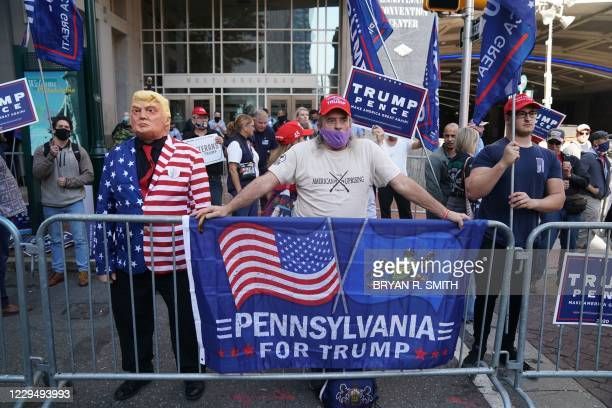 Supporters of US President Donald Trump protest outside the Pennsylvania Convention Center as ballot counting continues inside on November 6, 2020 in...