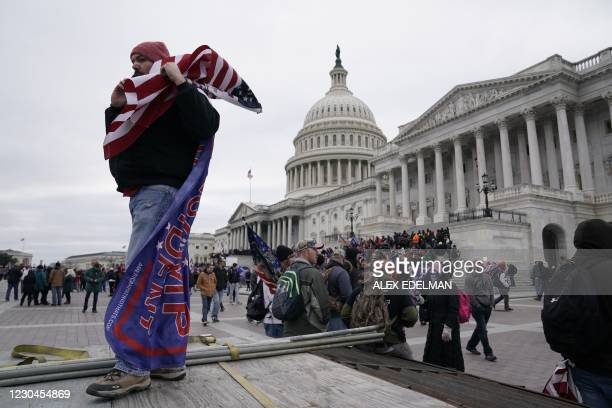Supporters of US President Donald Trump protest outside the US Capitol on January 6 in Washington, DC. - Demonstrators breeched security and entered...