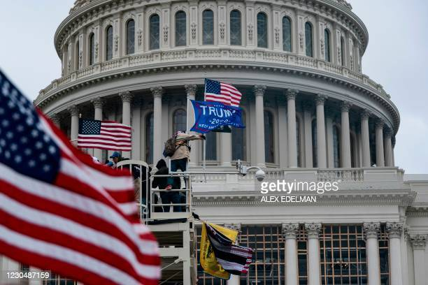 Supporters of US President Donald Trump protest outside the US Capitol on January 6 in Washington, DC. - Donald Trump's supporters stormed a session...