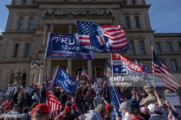 Supporters of US President Donald Trump rally at the State Capitol in Lansing, Michigan, on November 7 after Democratic Presidential nominee Joe...