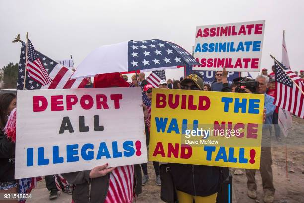 Supporters of US President Donald Trump rally for the president during his visit to see the controversial border wall prototypes on March 13 2018 in...