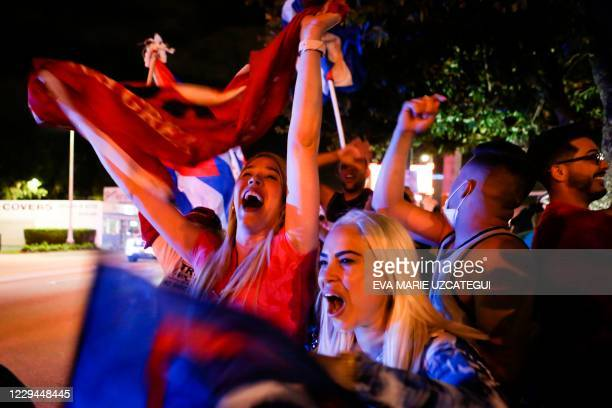 Supporters of US President Donald Trump rally in front of Cuban restaurant Versailles in Miami, Florida on November 3, 2020. - Americans were voting...