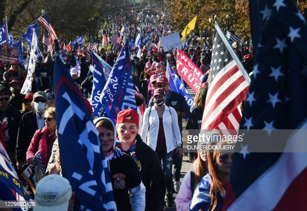 Supporters of US President Donald Trump rally in Washington, DC, on November 14, 2020. - Supporters are backing Trump's claim that the November 3...