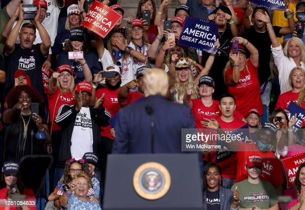 Supporters of U.S. President Donald Trump react as he concludes speaking at a campaign rally at the BOK Center, June 20, 2020 in Tulsa, Oklahoma....