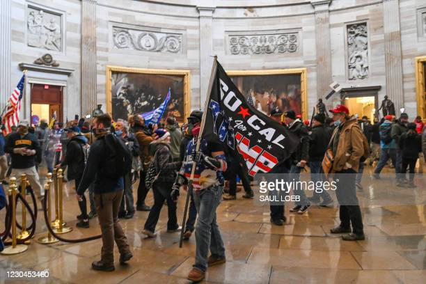 Supporters of US President Donald Trump roam under the Capitol Rotunda after invading the Capitol building on January 6 in Washington, DC. -...