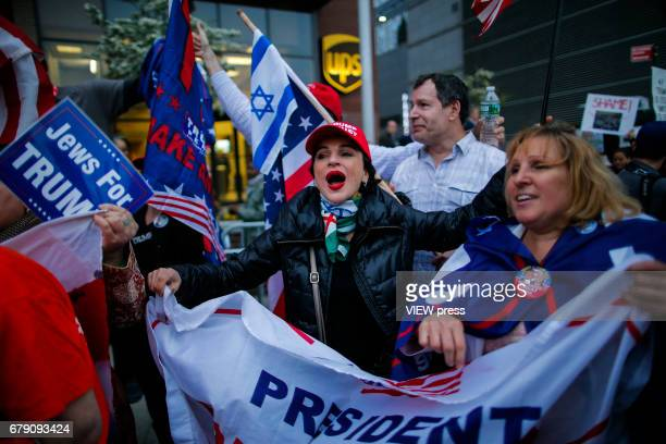 Supporters of US president Donald Trump shout slogans pro Trump while Activists take part in a protest near the USS Intrepid where US president Trump...