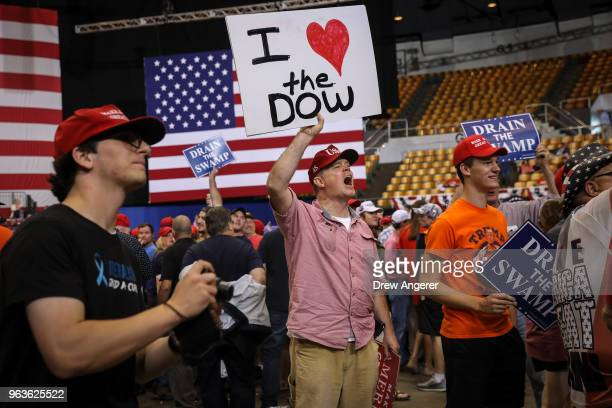 Supporters of US President Donald Trump shout toward members of the press before the start of a rally at the Nashville Municipal Auditorium May 29...