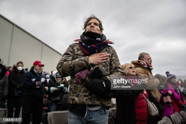 Supporters of U.S. President Donald Trump stand for the national anthem ahead of his arrival to a campaign rally on November 01, 2020 in Washington,...
