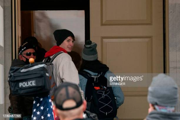 Supporters of US President Donald Trump storm into the US Capitol on January 6 in Washington, DC. - Donald Trump's supporters stormed a session of...