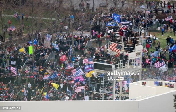 Supporters of US President Donald Trump take over stands set up for the presidential inauguration as they protest at the US Capitol in Washington,...