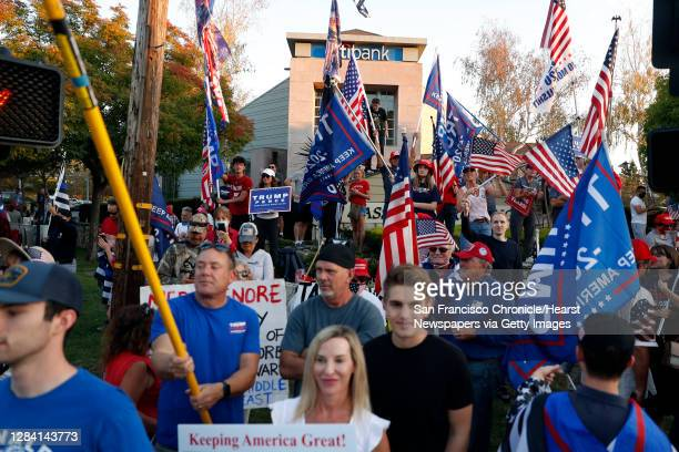 """Supporters of US President Donald Trump take part in a """"Trump Town USA Rally"""" at the intersection of Crow Canyon Road and Camino Tassajara in..."""
