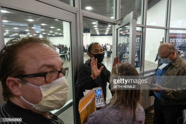 Supporters of US President Donald Trump try to enter the room where absentee ballots for the 2020 general election are being counted at TCF Center on...