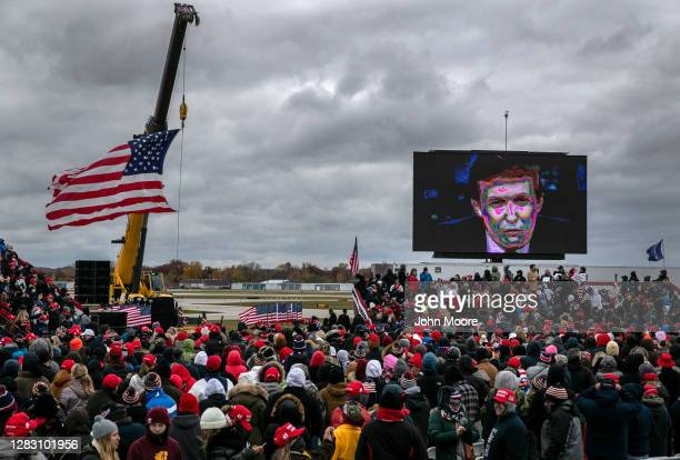 Supporters of U.S. President Donald Trump wait for his arrival to a campaign rally at Oakland County International Airport on October 30, 2020 in...