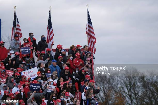 Supporters of U.S. President Donald Trump wait to hear him speak ahead of a during a campaign event on October 24, 2020 in Circleville, Ohio....
