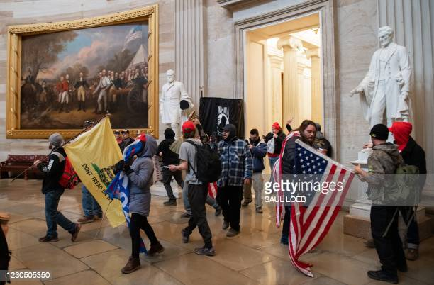 Supporters of US President Donald Trump walk around in the Rotunda after breaching the US Capitol in Washington, DC, January 6, 2021. - The...