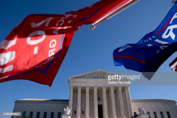 Supporters of U.S. President Donald Trump wave Trump flags outside of the U.S. Supreme Court on December 11, 2020 in Washington, DC. More than 100...
